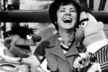 Joan Ganz Cooney with Bert and Ernie