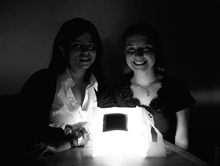 LuminAID co-founders Andrea and Anna with an early, homemade prototype