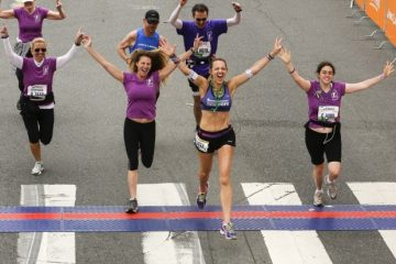 Julie Weiss Crossing the LA Marathon Finish Line