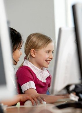girls learning on computer