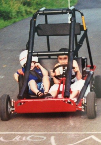 Julia driving_sibling_in go-kart