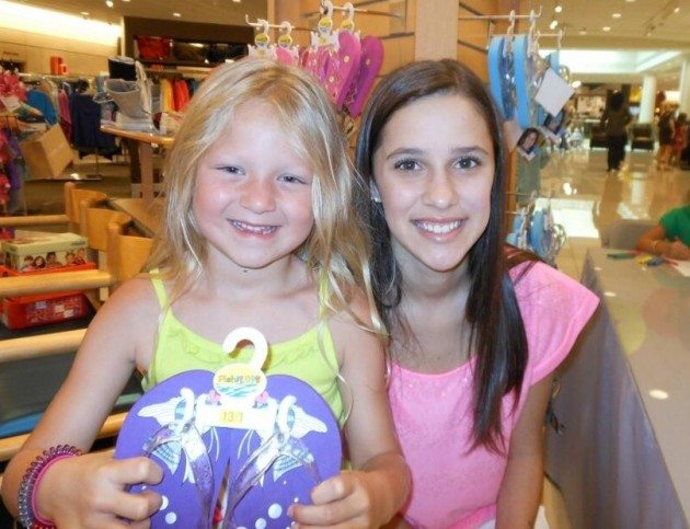 Maddie with a happy, pint-sized Nordstrom's customer