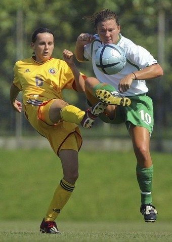 Romania's Iusan fights for the ball with Ireland's O'Brien during their UEFA Women's Championship Group 2 qualifying round soccer match in Mogosoaia