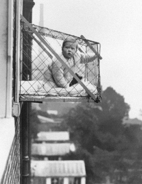 Baby cages for families living in apartments who wanted their children to get enough sunlight (1930's).