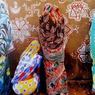 """Art for Life"" greeting card showing women of Pushkar, Rajasthan India painting traditional designs on a wall."