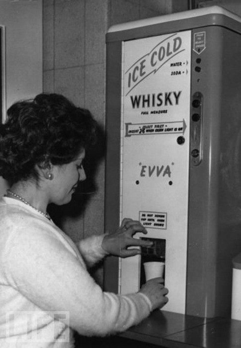 Whisky dispenser, sometimes found in offices. (1950's). We are thinking that this one should make a comeback!