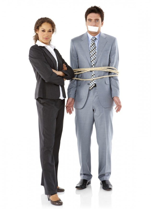 Businesswoman With a Captive Businessman - Isolated