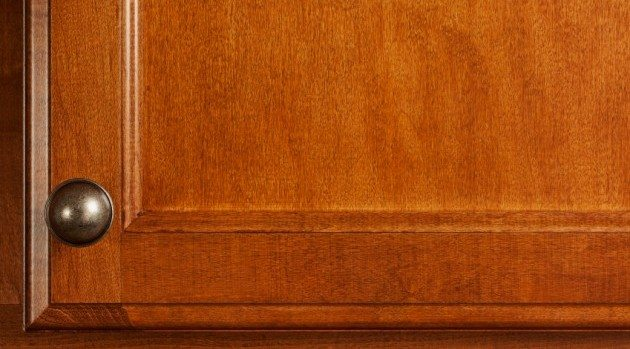 Detail of Cherry Wood Kitchen Cabinet Door with Handles