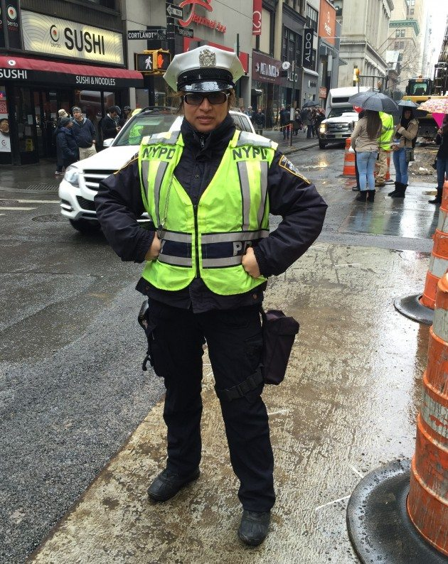 This Superhero is directing traffic and keeping everyone safe.