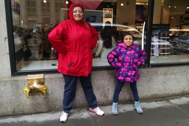 This Superhero is a retired NYPD Officer and her sidekick Supergirl is all heart.