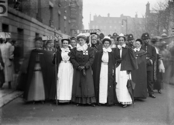 Nurses and midwives marching in their uniforms to the Albert Hall as part of the Pageant of Women's Trades and Professions, April 1909.