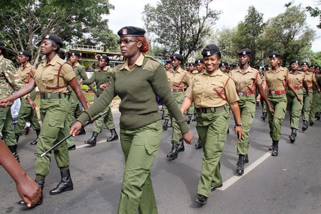 Officer Lucy Nduati (second in line, front row) smiles as she marches alongside her fellow Kenyan women police officers during a parade. Photo: UN Women/Kennedy Okoth
